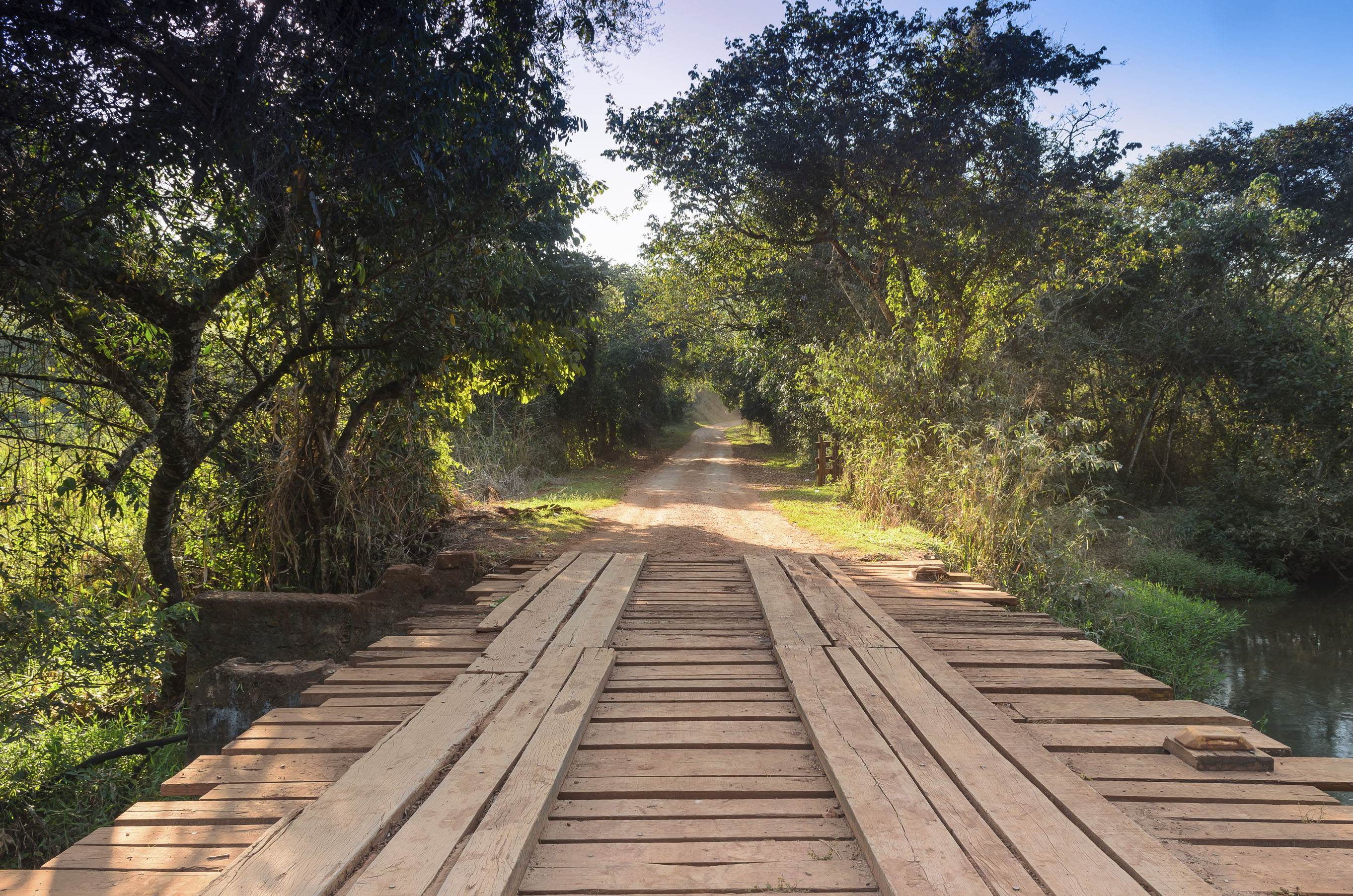 rural road with wood bridge
